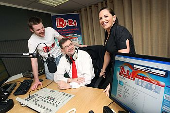 A new temporarily-licensed hit music station broadcasting in Irish was launched today by Minister of Community, Rural and Gaeltacht Affairs Eamon Ó'Cuiv (pictured below, being interviewed on air this morning).