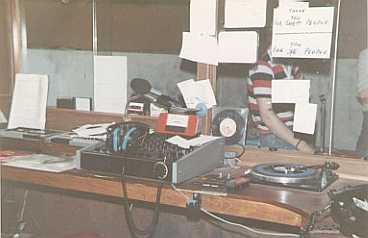 This is Kildare Community Radio, a Naas-based pirate station. Made on August 15th 1981, these recordings were made by the DX Archive team during a visit to the station. The photo of the studio was also taken at that time.